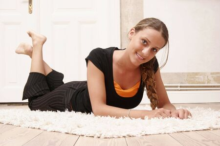 fifteen year old: Fifteen year old girl is posing on the ground Stock Photo