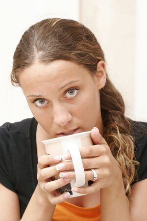 fifteen year old: Fifteen year old girl is drinking coffee Stock Photo