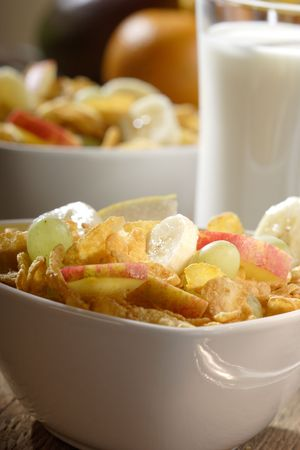 Corn flakes with slices of apples, grapes and bananas Stock Photo - 1913753