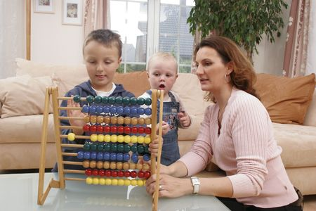 teaches: Kids playing with abacus and mother teaches
