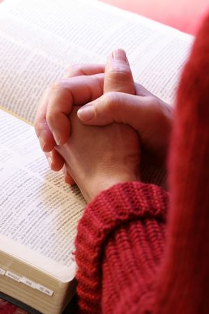 intercession: a woman is praying