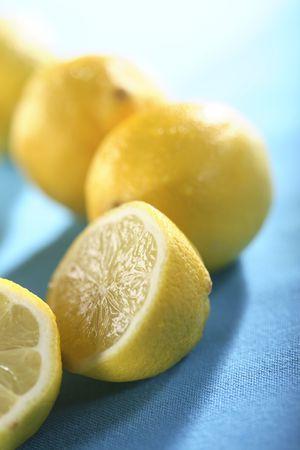 halved  half: lemons against blue background
