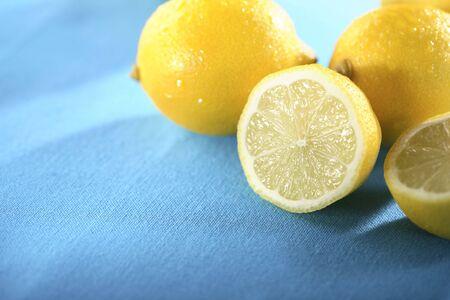 bisected: lemons against blue background