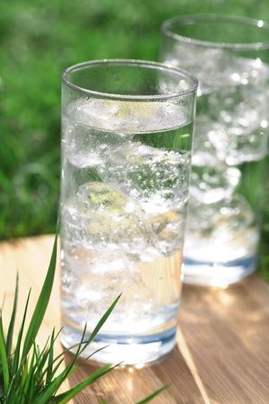 icecubes: sparkling water with icecubes on a meadow Stock Photo