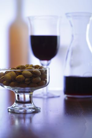 redwine: still life with red wine and pistachios