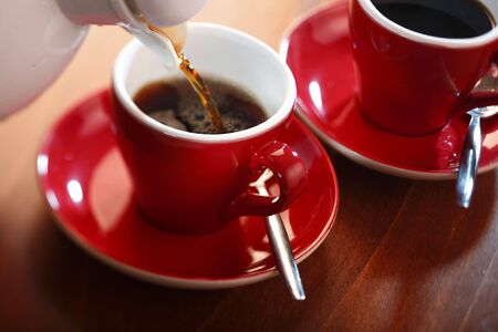 brewed: fresh brewed coffee in a red cup Stock Photo