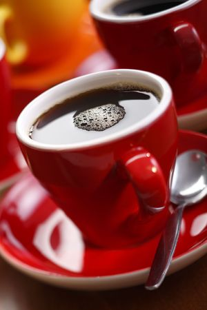 fresh brewed coffee in a red cup Banco de Imagens