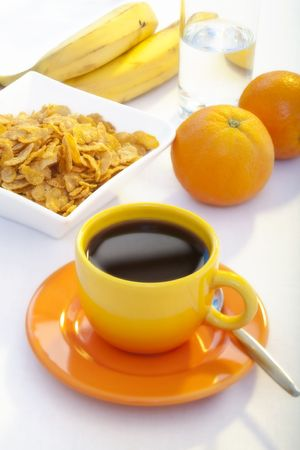 coffee with cornflakes and fruits photo