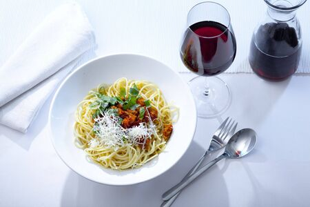 bolognese sauce: plate with Spaghetti Bolognese and red wine Stock Photo