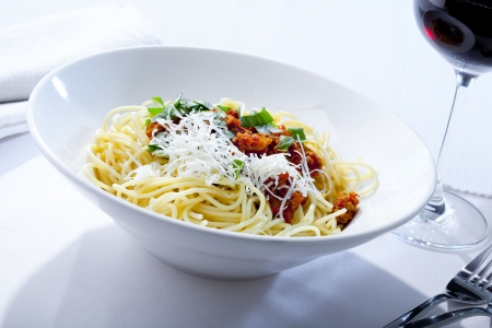 bolognese: plate with Spaghetti Bolognese and red wine Stock Photo