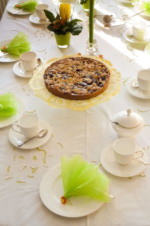 cocooning: Table laid for coffee and cake Stock Photo