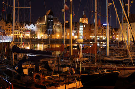 Night panorama of Old Town's waterfront in Gdansk. Yachts moored at Motlawa river.