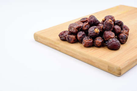 Dried dates on a chopping board