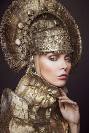 head wear: Woman in gold kokoshnik head wear Stock Photo
