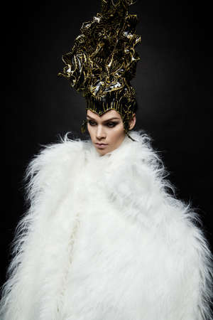 headwear: Woman in headwear and fur coat