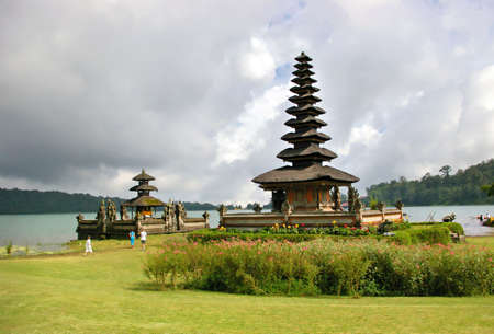 mysteriouse Balinese temple beside lake photo