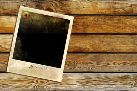 old frame over wooden wall photo