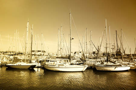 yachts on peaceful moprning quay - artistic toned picture photo