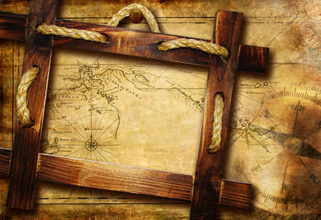 treasure map: vinatge background with wooden frame over old map