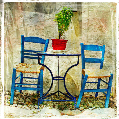 pictorial: pictorial details of Greece - old chairs in taverna- retro styled picture Stock Photo