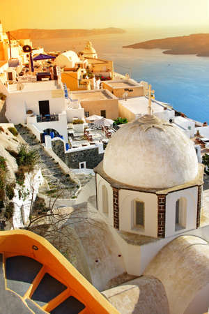Oia village at sunset, Santorini island, Greece  photo