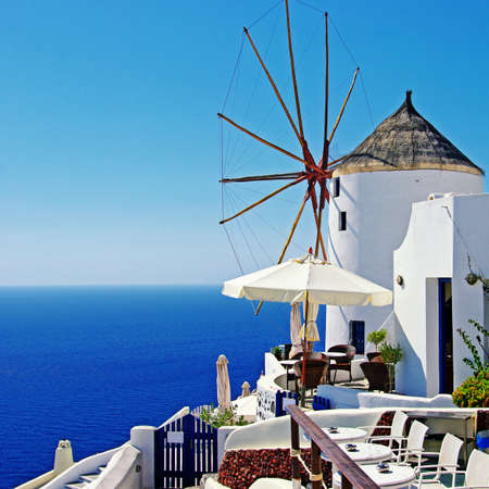 santorini greece: Santorini - Oia town, bar with windmill
