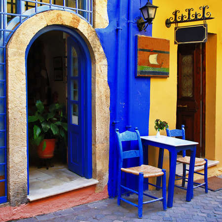 traditional greek streets with small tavernas  photo