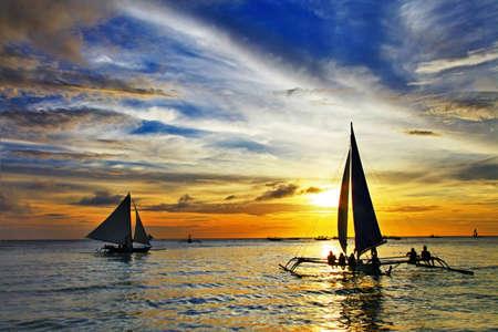 sailing on sunset Stockfoto