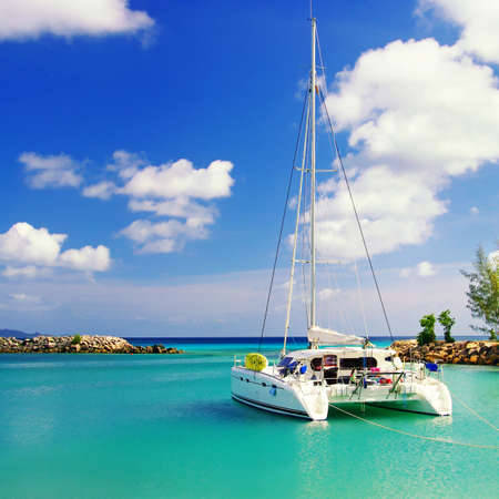 tranquil scene in sunny morning on Seychelles with sailing boat  photo
