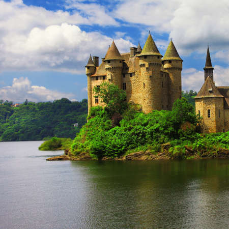 cantal: Chateau de Val - castle on lake, France Editorial