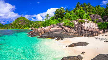 emerald sea and white beaches of Seychelles photo
