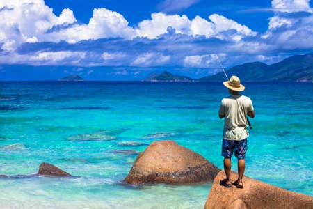 granit: fishing in turquoise ocean, seychelles islands