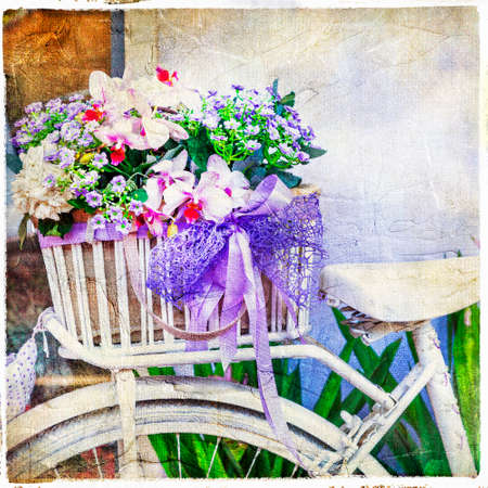 orchid house: floral decoration and old bike - retro picture Stock Photo
