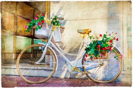 courtyard: vintage cart - floral bike Stock Photo