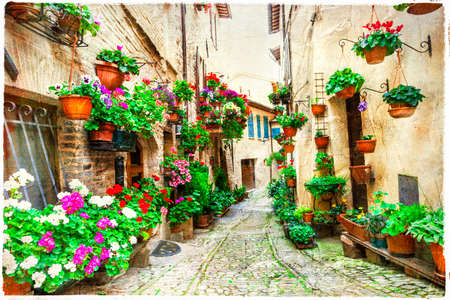 greek pot: affascinanti strade floreali in Spello, Umbria, Italia Archivio Fotografico