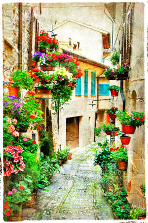 greek pot: charming streets with flowers in Spello.Umbria, Italy, artistic picture