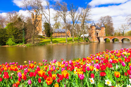 Beautiful castles of Belgium - Groot Bijgarden with blooming tulips