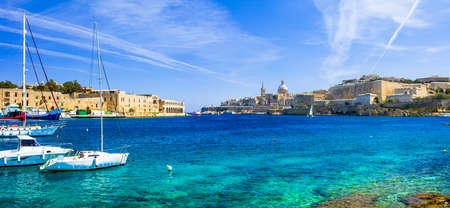azzure sea of ??Malta and view of Valletta town