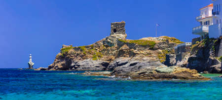 mediterranean culture: Andros island - view with old fortress and light house Stock Photo