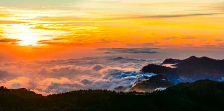 top mountain: sunset over clouds - impressive mountains of Gran Canaria island Stock Photo