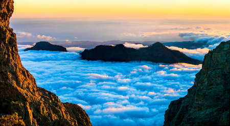 sunset over clouds - impressive mountains of Gran Canaria island Stock Photo