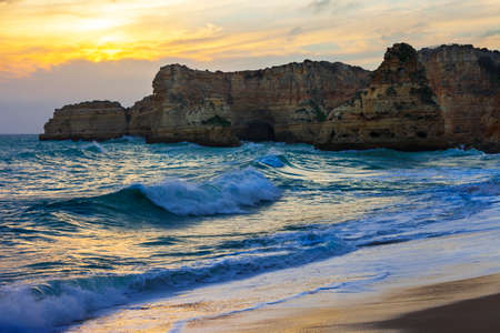 praia: sunset in beautiful beach Praia da Marinha - Algarve, Portugal Stock Photo