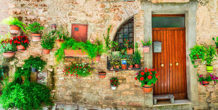 brick house: beautiful floral street decoration in Spello - medieval vllage in Umbria, Italy