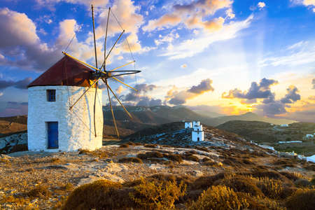 Windmils over sunset. Amorgos island, Greece