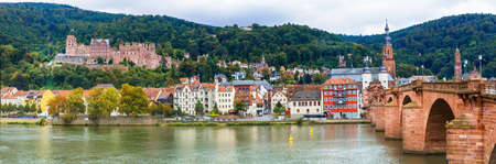 theodor: beautiful medieval Heidelberg town, view with bridge and castle. Germany