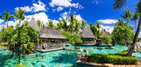 pool bar: tropical holidays - exotic bar in swimming pool. Mauritius island