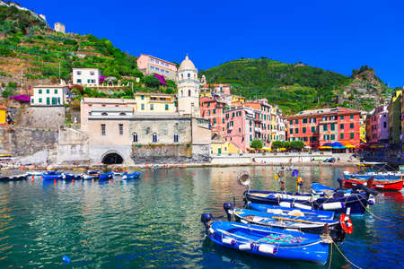 Panoramic view of Vernazza village, fishing boats and colored houses, Cinque Terre, Liguria, Italy.