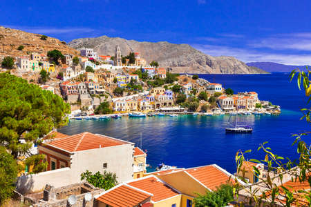 sea of houses: Beautiful symi island, panoramic view with houses and sea, Greece. Stock Photo