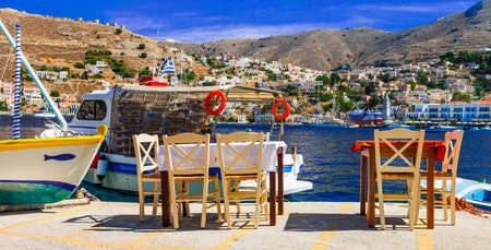 Traditional tavern in Symi Island, Dodecanese, Greece. Stock Photo