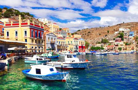halki: Impressive Symi island, sea and fishing boat, Greece.